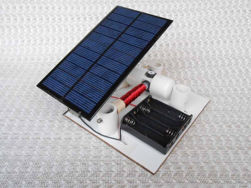 Reed switch motor with solar panel