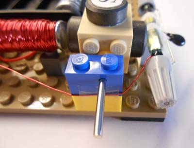 Taped wire and supported electromagnet